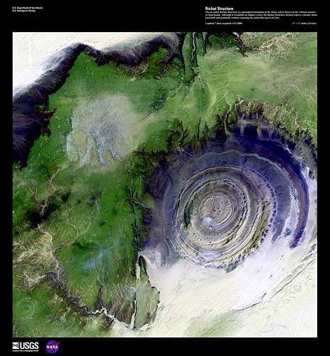 Richat Structure, imaged on January 1, 2001 by Landsat 7. The so-called Richat Structure is a geological formation in the Maur Adrar Desert in the African country of Mauritania. Although it resembles an impact crater, the Richat Structure formed when a volcanic dome hardened and gradually eroded, exposing the onion-like layers of rock. Credit: USGS/EROS.