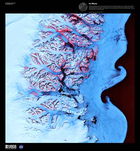 Ice Waves, imaged on May 21, 2001 but Landsat 7. Along the southeastern coast of Greenland, an intricate network of fjords funnels glacial ice to the Atlantic Ocean. During the summer melting season, newly calved icebergs join slabs of sea ice and older, weathered bergs in an offshore slurry that the southward-flowing East Greenland Current sometimes swirls into stunning shapes. Exposed rock of mountain peaks, tinted red in this image, hints at a hidden landscape. Credit: USGS/EROS.