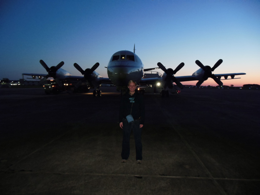 Christy Hansen stands in front of an airplane at Wallops Flight Facility in Virginia. This plane took her to Greenland this past April. Credit: Matt Linkswiler