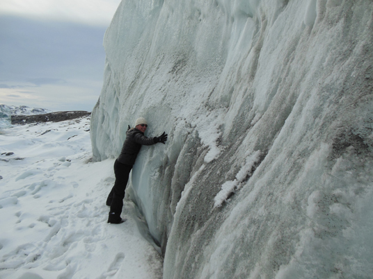 Christy Hansen hugs the Russell glacier, part of the Greenland Ice Sheet. Credit: Christy Hansen