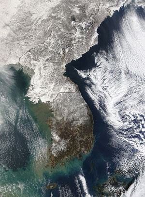 Korean Peninsula: On the other side of the world, Arctic weather was also brought to bear on the Korean Peninsula. This image was taken on Jan. 3, 2010. Scientists say this year's severe winter weather is still to be expected from time to time, even as increased concentrations of man-made greenhouse gases create a long-term warming trend for the planet. 