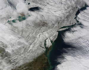 United States: The same pattern with the Arctic Oscillation brought harsh winter conditions to the United States as well. Snow blanketed the East Coast just days before Christmas. Nearly two feet of snow covered the Washington, D.C. area. Image courtesy of NASA, MODIS Rapid Response Team.