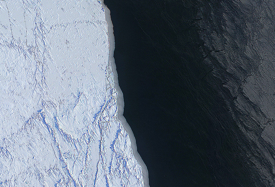 The margin of a large lead of open water (dark) and thin grease ice (gray, right) in the Chukchi Sea between Alaska and Russia. The image was made with several frames from the Digital Mapping System (DMS) onboard the NASA P-3. Credit: NASA/DMS/Eric Fraim