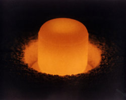 A plug of plutonium, which provides heat for TE generators in space. On the road, waste heat from car engines and exhaust pipes will do the job.