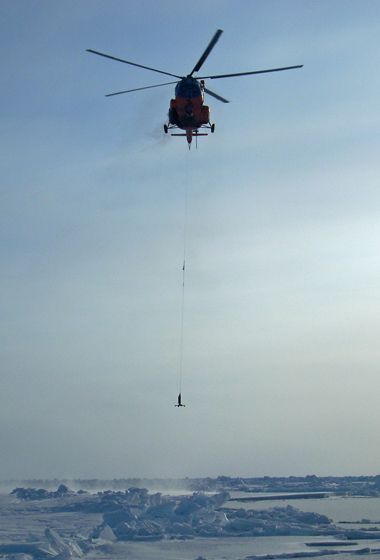 An instrument about to be dropped through an opening in the ice to the seafloor will record ocean bottom pressure to compare with similar data recorded by NASA's GRACE satellites. Data from GRACE, ICESat and actual water samples led to the discovery of a new pathway of freshwater in the Arctic. Credit: C. Peralta-Ferriz/UW Applied Physics Laboratory