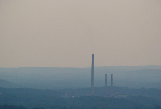 Smokestacks from a coal power plant in Maryland jut into a hazy skyline. Credit: Jeff Stehr, University of Maryland