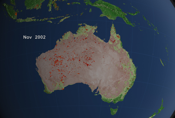 Widespread grassland fires burned large portions of of Australia's interior in 2002. The brightest fires, as observed by the MODIS instrument, are shown in orange and yellow. (Credit: NASA)