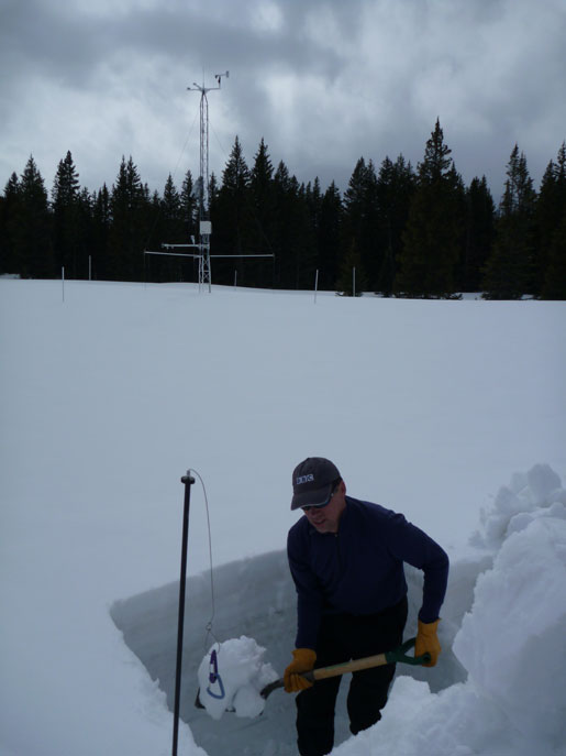 Tom Painter digging out a new snowpit. Samples will be used to measure the melt rates of dirty snow.