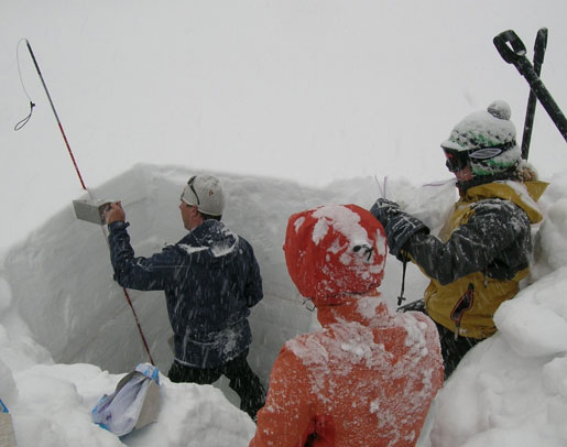 Taking snow samples as weather conditions worsen in the Colorado Mountains