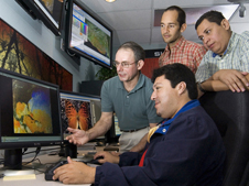 The SERVIR program brings satellite information to local decision makers to address threats related to climate change, biodiversity, and extreme events. University of Alabama-Huntsville scientist Danny Hardin (left) trains researchers from El Salvador to use SERVIR. Credit: SERVIR.