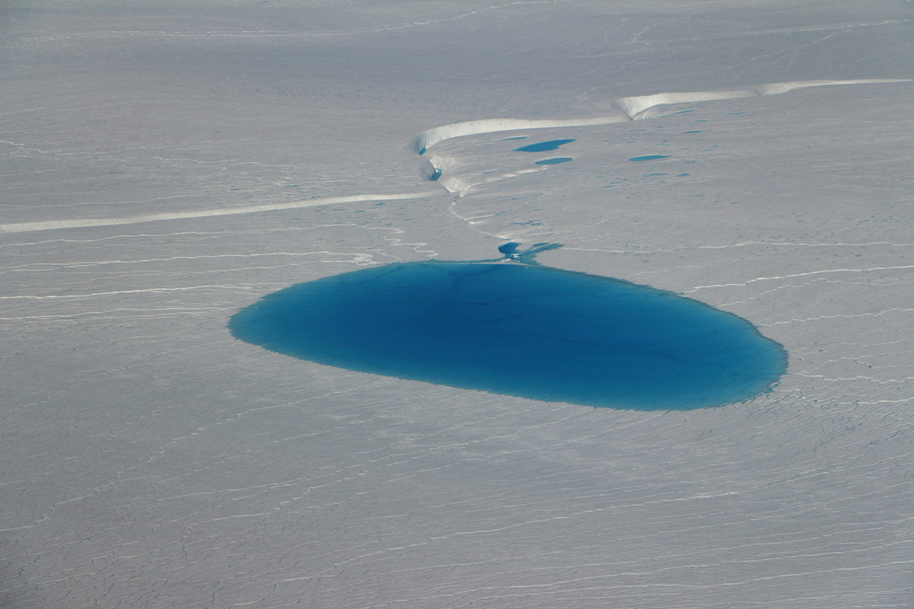 One of the dozen supraglacial lakes that Operation IceBridge surveyed to measure lake depth on July 19, 2017.