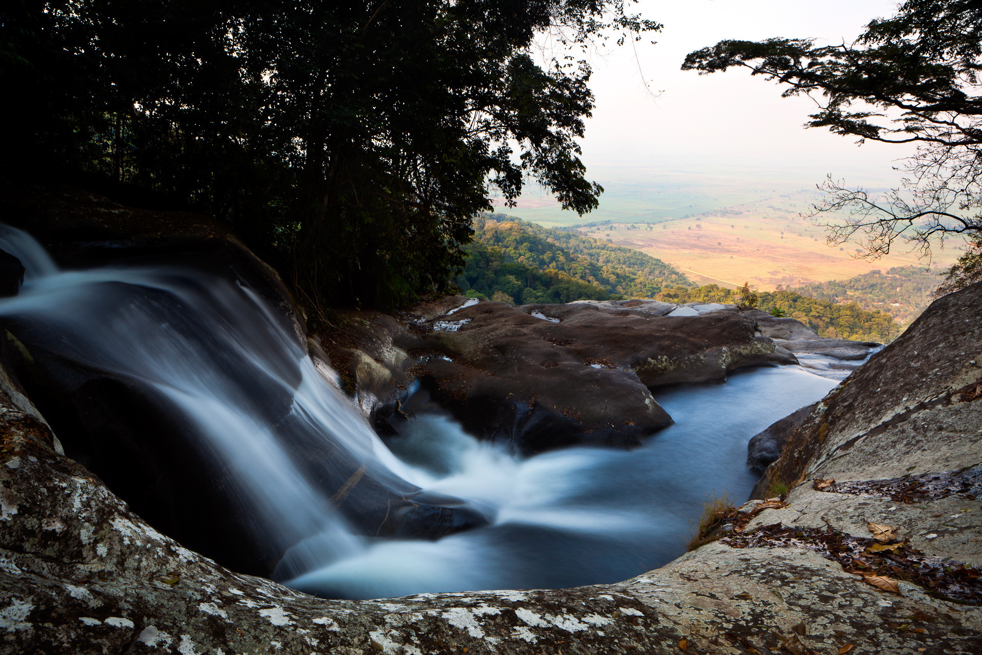 Sanje Waterfall in Udzungwa National Park, Tanzania, overlooks farmland that depends on its water.