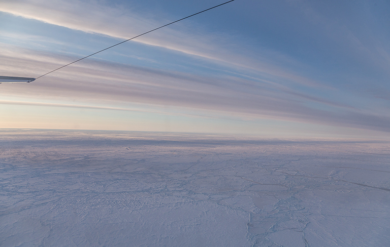 Snow-covered pack sea ice north of Greenland.