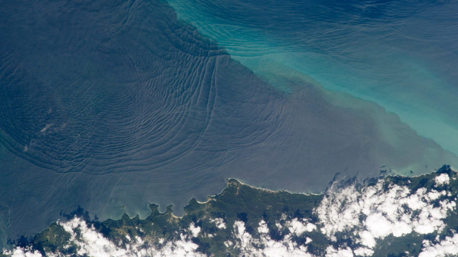 Waves swirl off the coast of Trinidad.