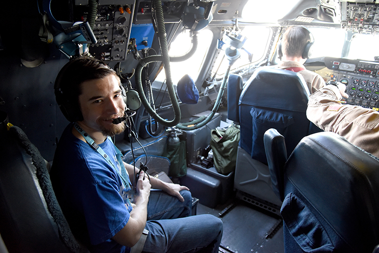 Student Airborne Research Program (SARP) participant Dallas McKinney, a meteorology major at Western Kentucky University, aboard the DC-8 experiencing the cockpit during a June 26, 2018 science flight. Credit: NASA/Megan Schill
