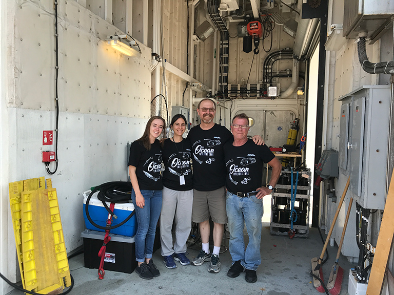 The WHOI EXPORTS team showed off their glow-in-the-dark ocean twilight zone t-shirts prior to departure from Seattle in August.
