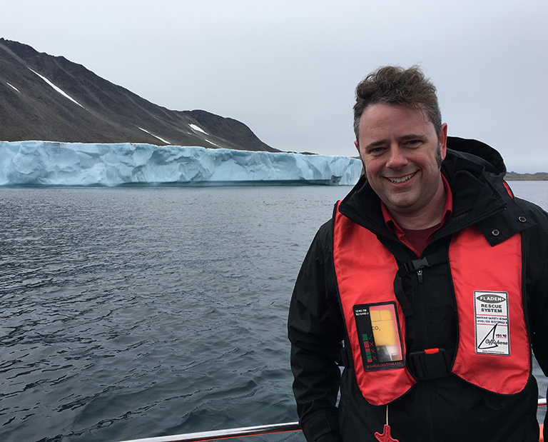 Josh Willis, OMG's principal investigator, on approach by boat to Apusiaajik glacier in Greenland.