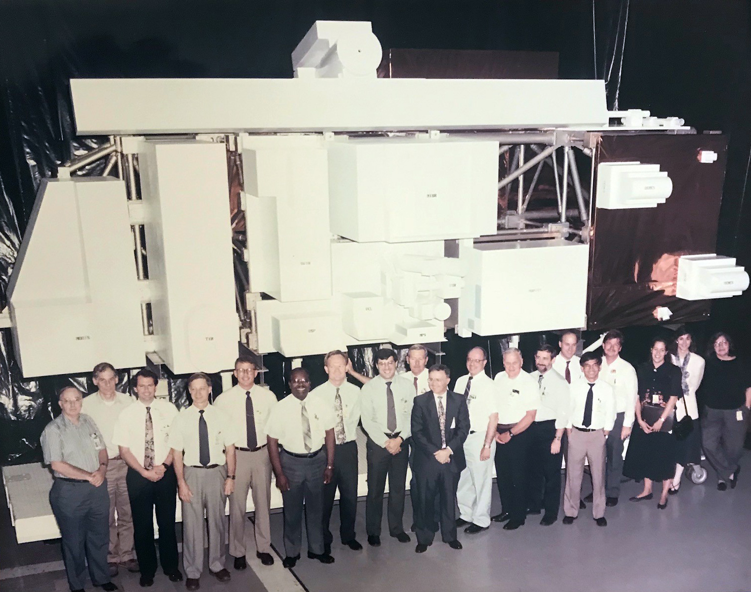 NASA scientists, engineers and designers pose for a group photo in front of the Terra model.