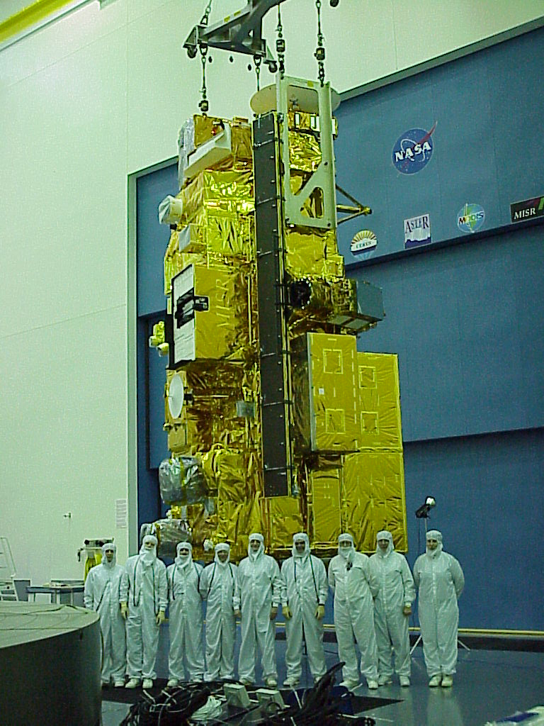 Terra's test team stands in front of the satellite during its construction and testing phase.