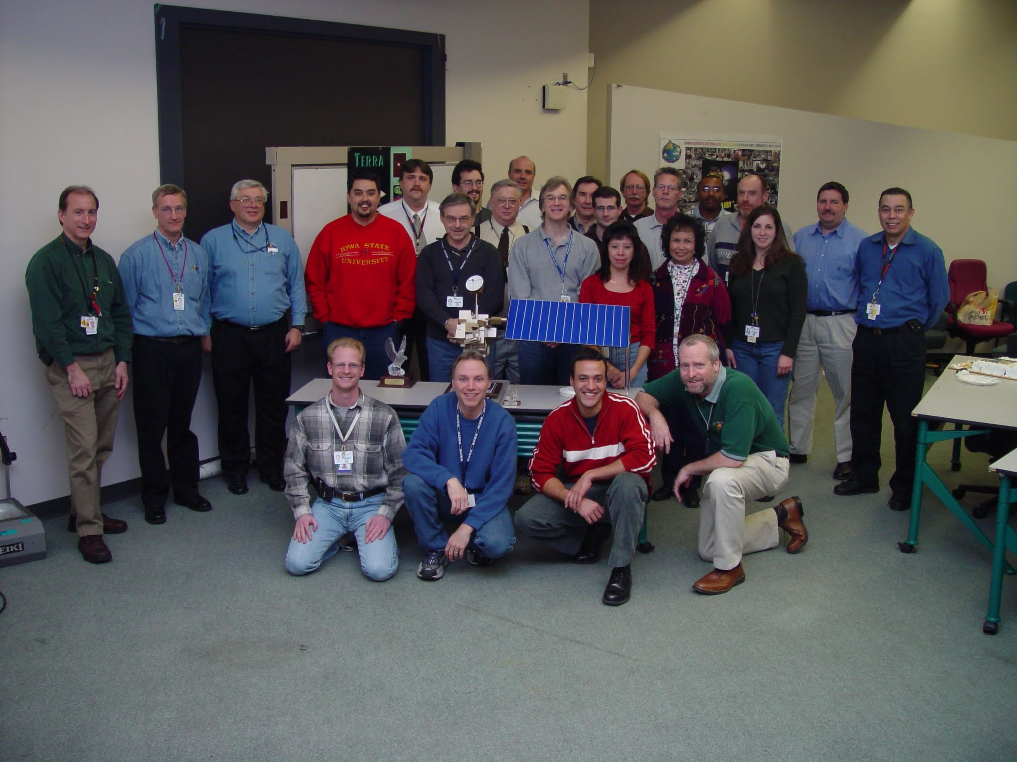 Celebrating the 10th anniversary of Terra in 2009, the flight operations leads and managers posed around a model of the satellite.