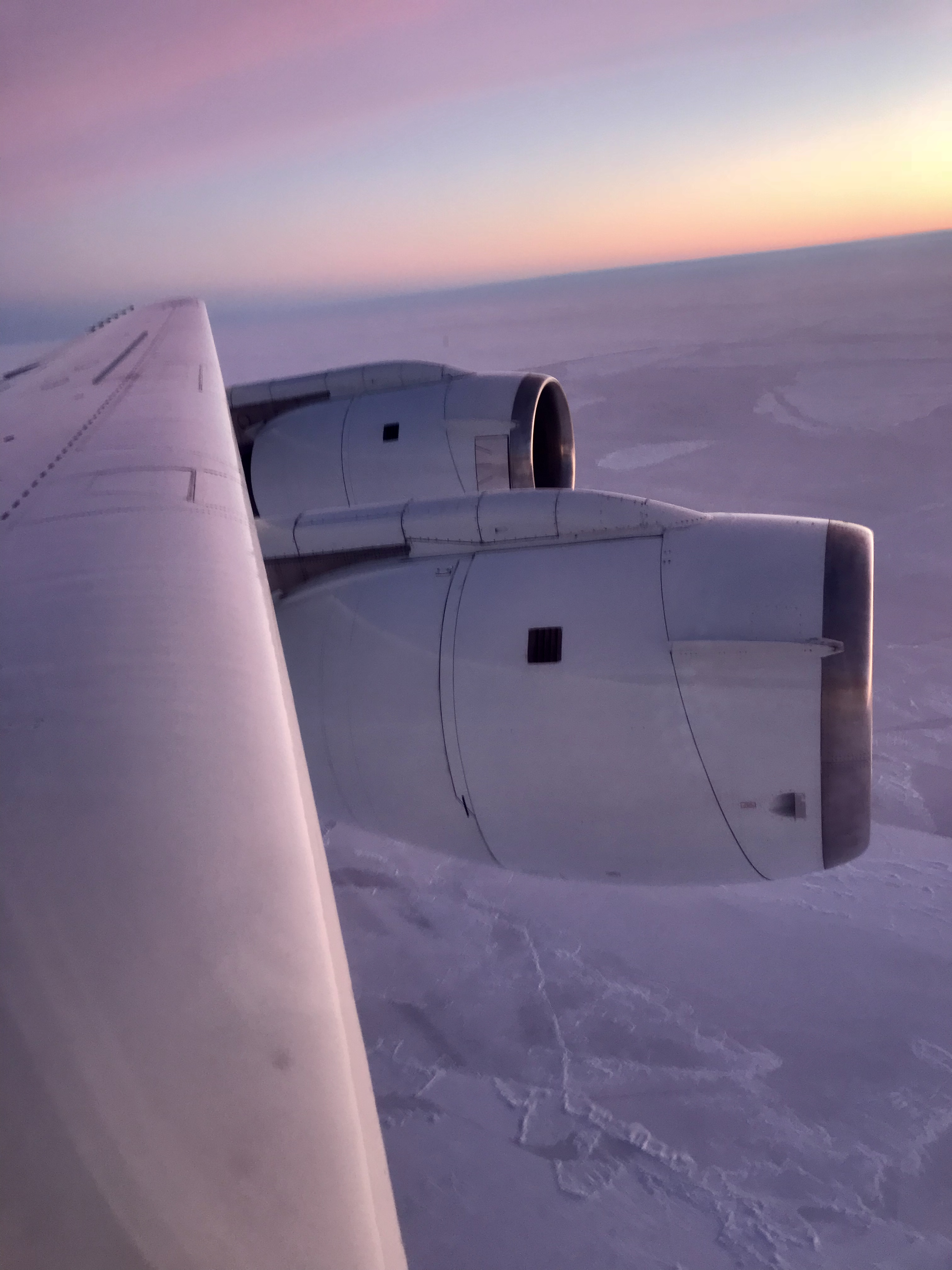 A view of NASA's DC-8 engines and wing as we were chasing the sea ice below.
