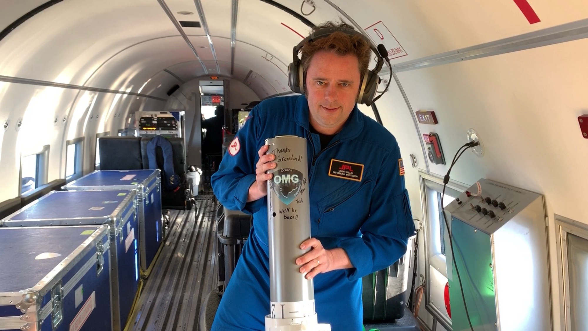 OMG Principal Investigator Josh Willis of NASA's Jet Propulsion Laboratory prepares to release the last ocean probe for OMG's 2019 ocean survey from the interior of an Airtec DC-3 Turbo aircraft.