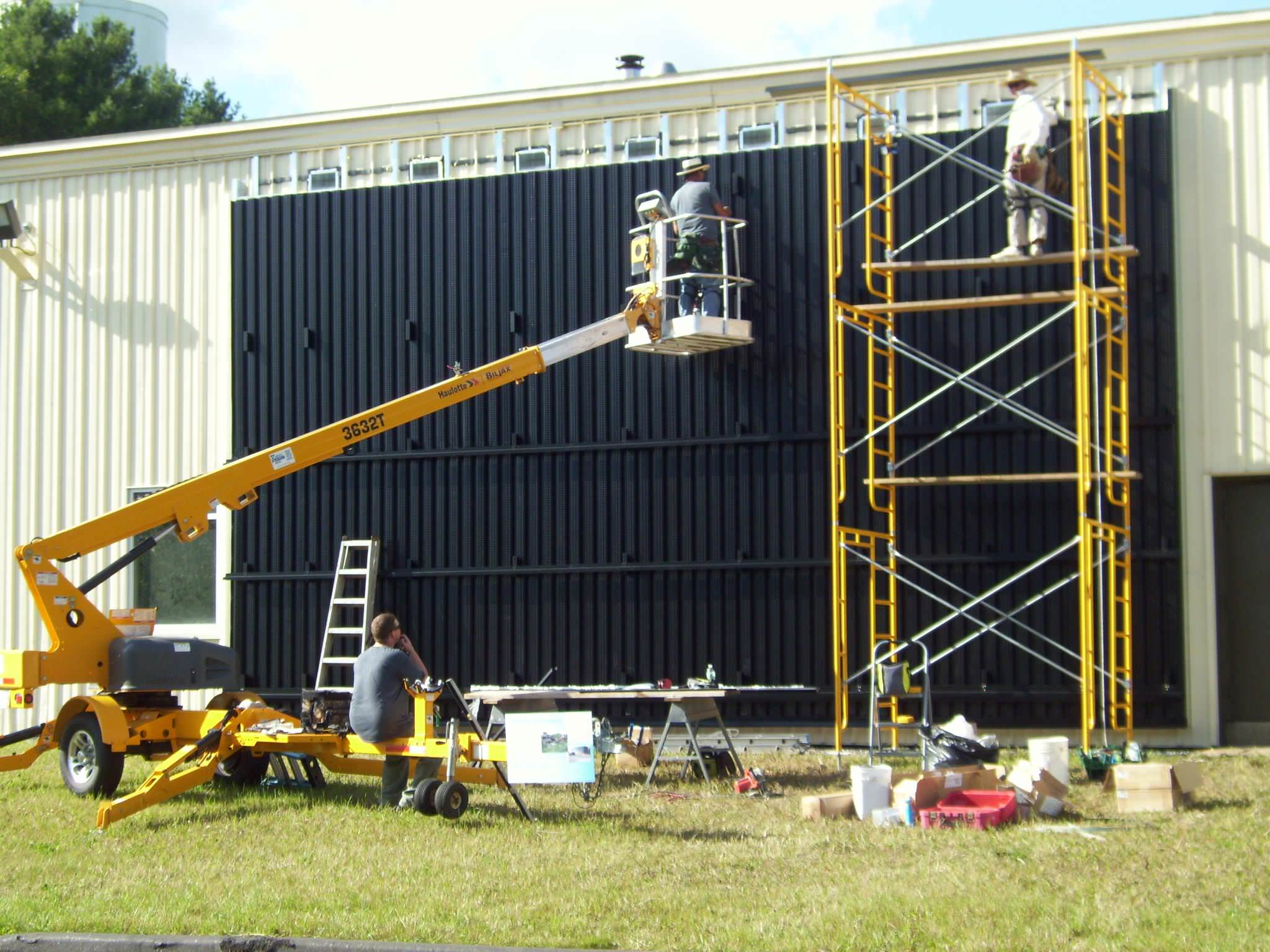 The installation of a solar wall at Wicked Joe's roastery in Maine.