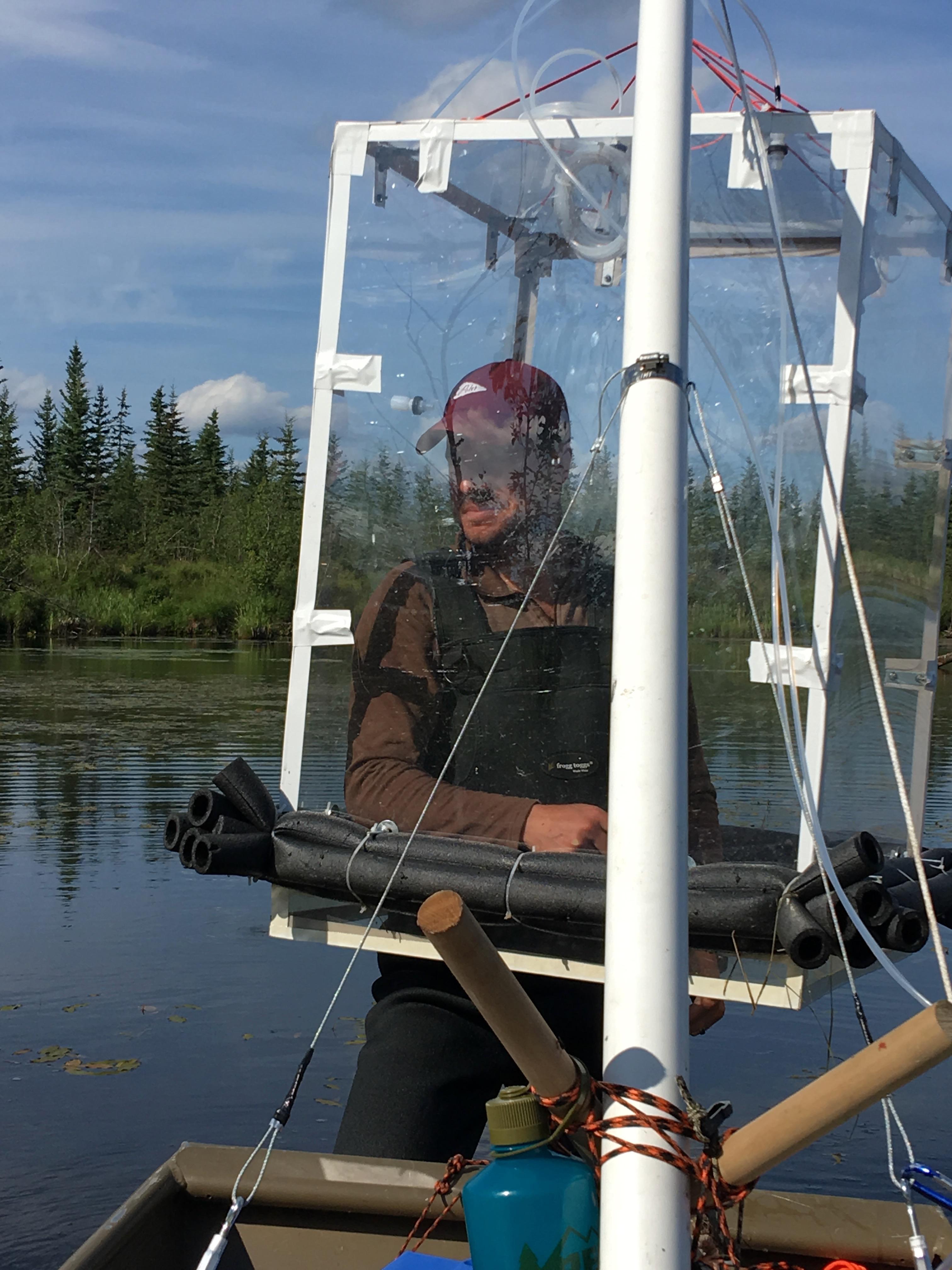 NASA JPL postdoctoral fellow Clayton Elder measures methane bubbling up from Big Trail Lake outside of Fairbanks, Alaska.