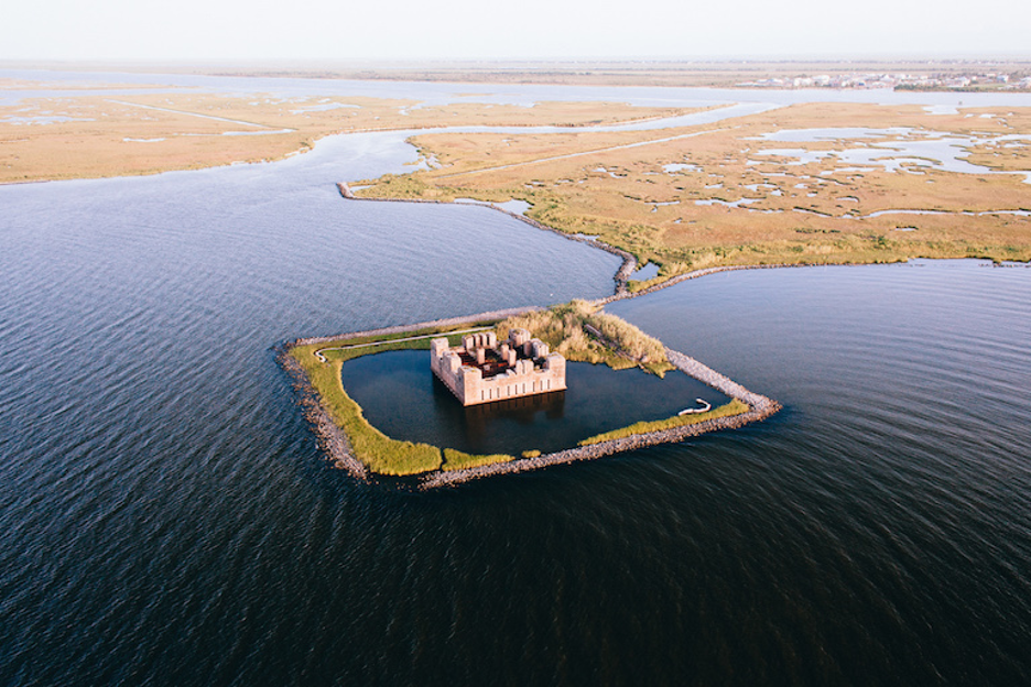 The ruins of a Civil War-era structure, Fort Beauregard, lie partially submerged east of New Orleans.