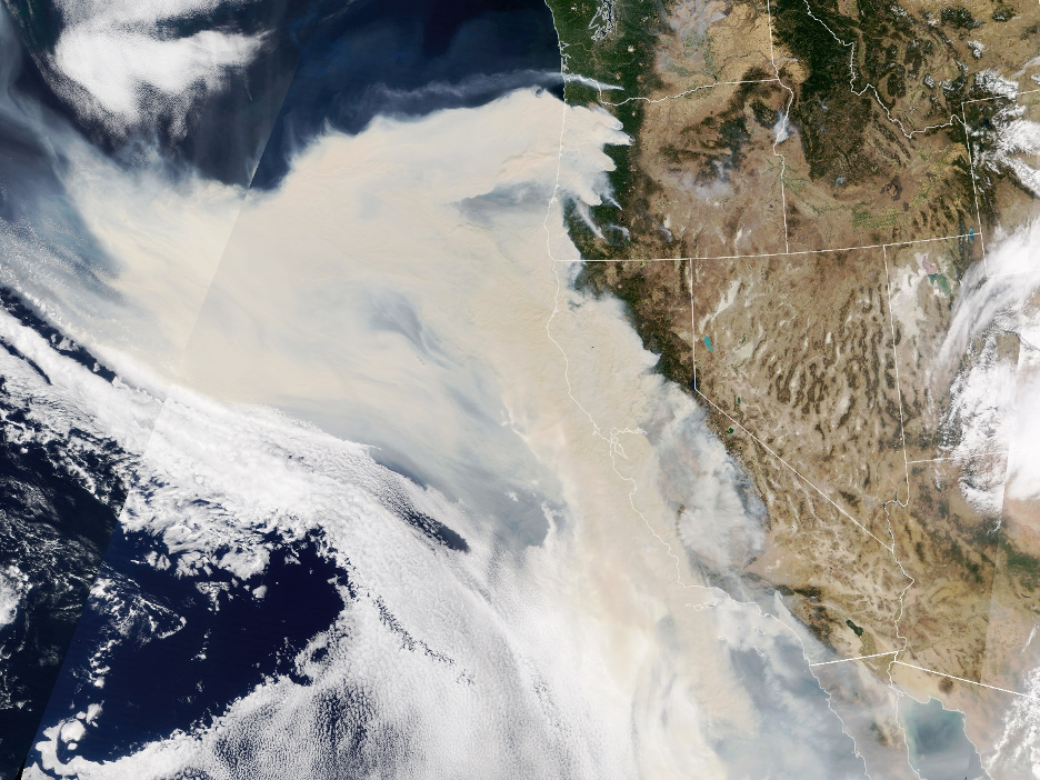 Thick smoke streaming from a line of intense wildfires in California and Oregon blankets much of the U.S. West Coast in this natural-color image captured September 9, 2020.