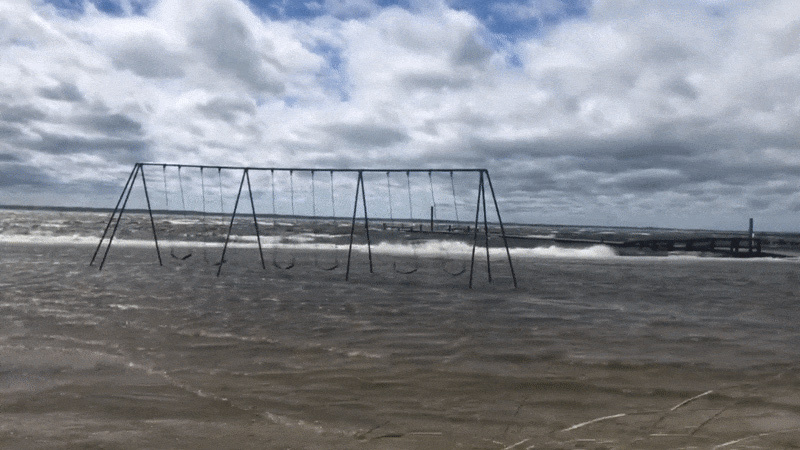 image of swing set getting flooded by ocean water