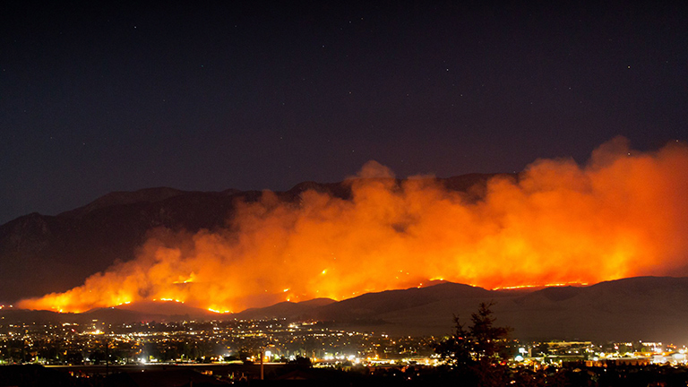 The Apple Fire burns into the night north of Beaumont, California, on Friday, July 31, 2020.