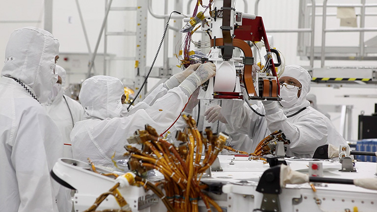 JPL engineers working on hardware in the clean room. Credit: NASA/JPL-Caltech.