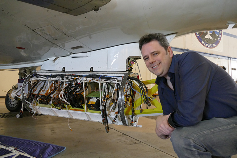 Dr. Josh Willis oversees integration of the GLISTIN-A radar instrument to the belly of the aircraft.
