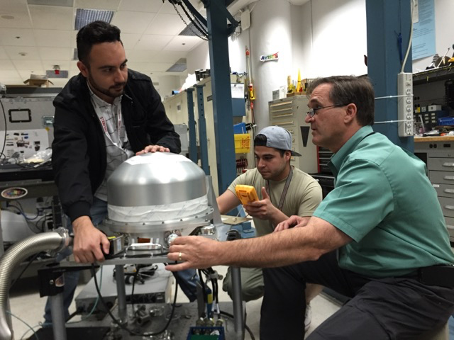 The PRISM instrument at JPL, undergoing testing in preparation for its use in the CORAL campaign by (left to right) CORAL systems engineer Ernesto Diaz, sensor technician Luis Rios and systems engineer Michael Eastwood. Credit: NASA/JPL-Caltech.