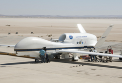 NASA's Global Hawk (pictured here) and a fleet of aircraft equipped with sophisticated sensors will fly 12 NASA campaigns around the world in 2014. From Antarctica to the Arctic, airborne scientists will study polar ice sheets, urban air pollution, hurricanes and more. Image Credit: NASA/Tony Landis