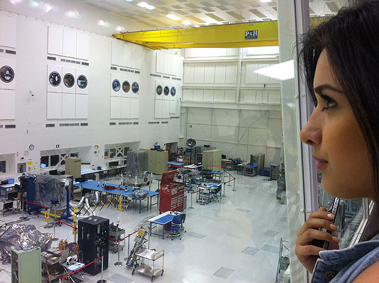 Glendale Community College student Alina Bedrosian in the high bay overlooking JPL's Spacecraft Assembly Facility used for assembly and test of space hardware similar to OCO-2.