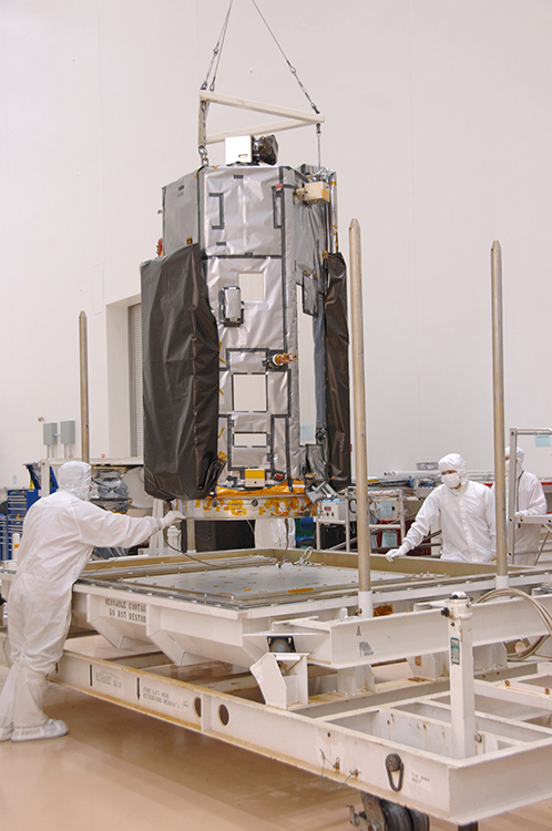 Technicians at Orbital Sciences Corp.'s Satellite Manufacturing Facility in Gilbert, Ariz., prepare NASA's Orbiting Carbon Observatory-2 spacecraft for shipment to its launch site at California's Vandenberg Air Force Base. Credit: Orbital Sciences Corp.