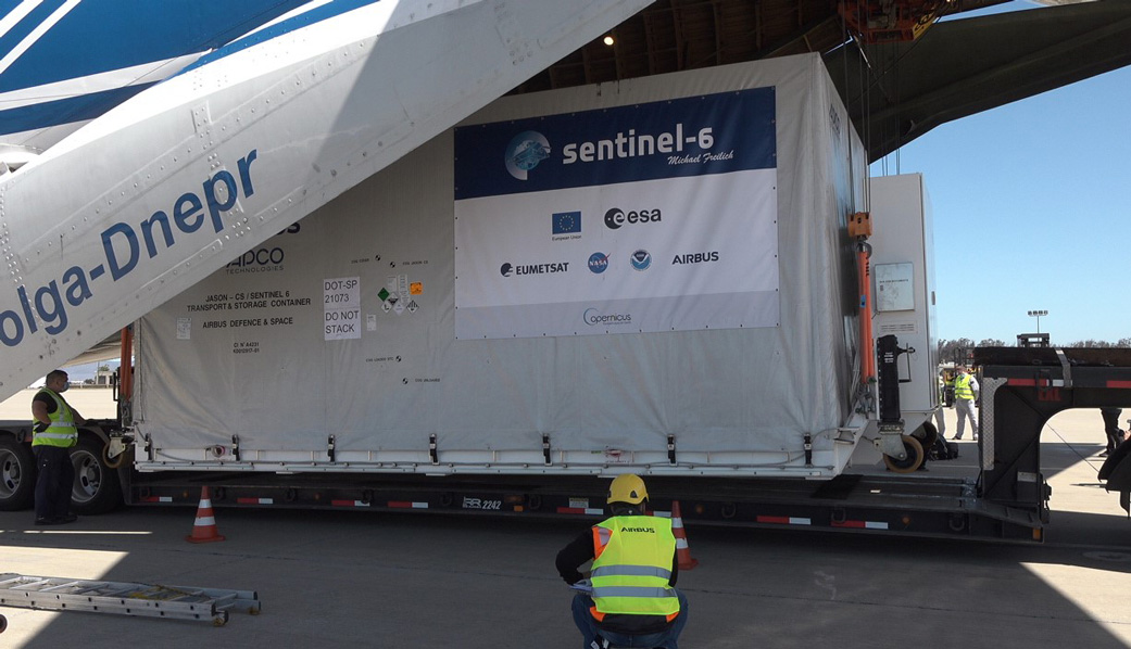 A shipping container containing the Sentinel-6 Michael Freilich satellite is removed from an Antonov 124 aircraft at Vandenberg Air Force Base in California
