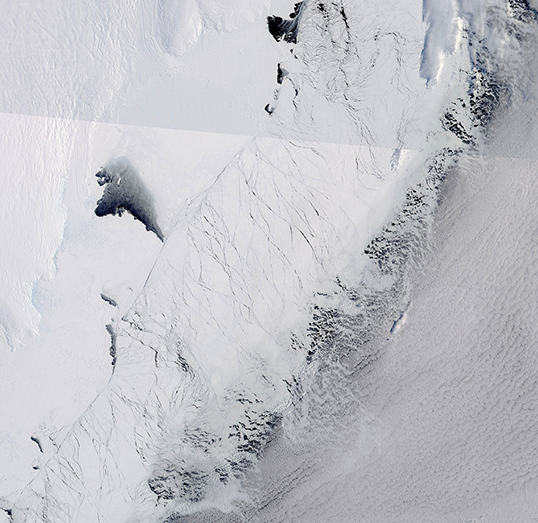 This image shows the Totten Glacier ice shelf in East Antarctica (the wrinkled white area at top left) on Sept. 25, 2013.