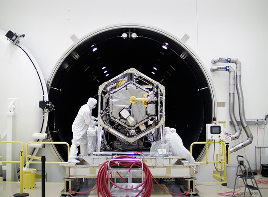 NASA's Orbiting Carbon Observatory (OCO)-2 spacecraft is moved into a thermal vacuum chamber at Orbital Sciences Corporation's Satellite Manufacturing Facility for a series of environmental tests. Credit: Orbital Sciences Corporation/NASA/JPL-Caltech.