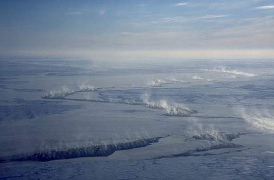 Cloud plumes from cracks of open water in the Arctic sea ice cover. Image credit: University of Hamburg, Germany