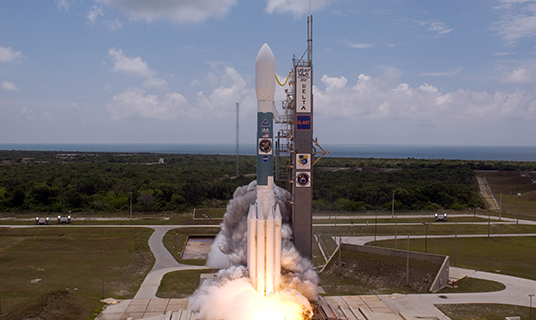 Five NASA Earth missions will be launched into space in the same year. Two of the satellites will ride atop a Delta II rocket similar to the one shown here at Cape Canaveral launch pad.