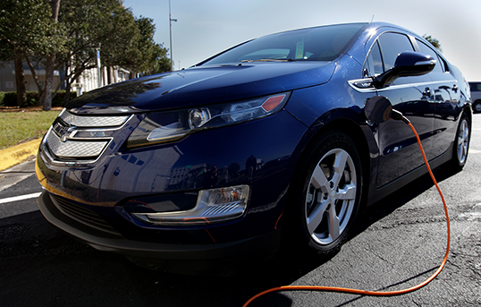 An electric car taking part in a program to investigate potential ways to lower emissions is seen plugged in at Kennedy. Image Credit: NASA