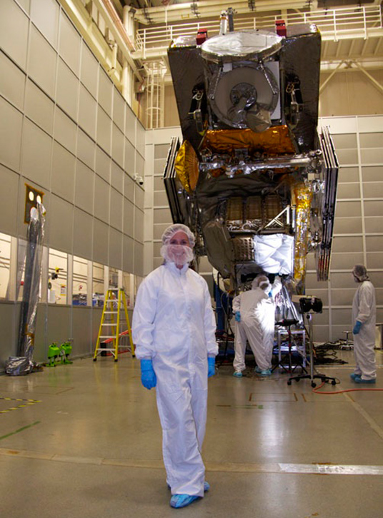 Dalia Kirschbaum wears a bunny suit in front of NASA's Global Precipitation Measurement (GPM) satellite, scheduled for launch Thursday, Feb. 27.