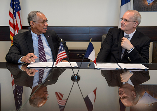 NASA Administrator Charles Bolden, left, and Centre National d'Études Spatiales (CNES) President Jean-Yves Le Gall talk after signing an agreement to move from feasibility studies to implementation of the Surface Water and Ocean Topography (SWOT) mission at NASA Headquarters in Washington. The SWOT mission will use wide swath altimetry technology to produce high-resolution elevation measurements of the surface of lakes, reservoirs and wetlands and of the ocean surface. Image credit: NASA/Bill Ingalls