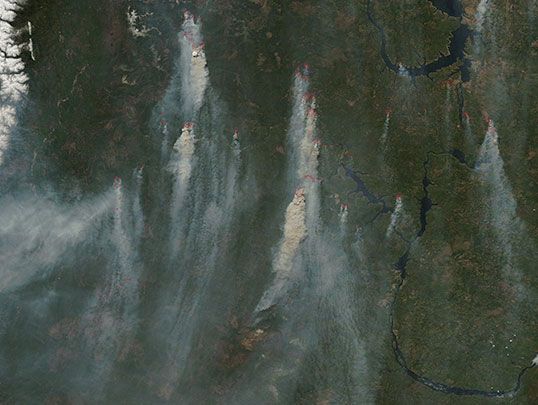 Scientists will use measurements from the Orbiting Carbon Observatory-2 to track atmospheric carbon dioxide to sources such as these wildfires in Siberia, imaged on May 18 by NASA's Moderate Resolution Imaging Spectrometer. Credit: NASA/LANCE/EOSDIS Rapid Response