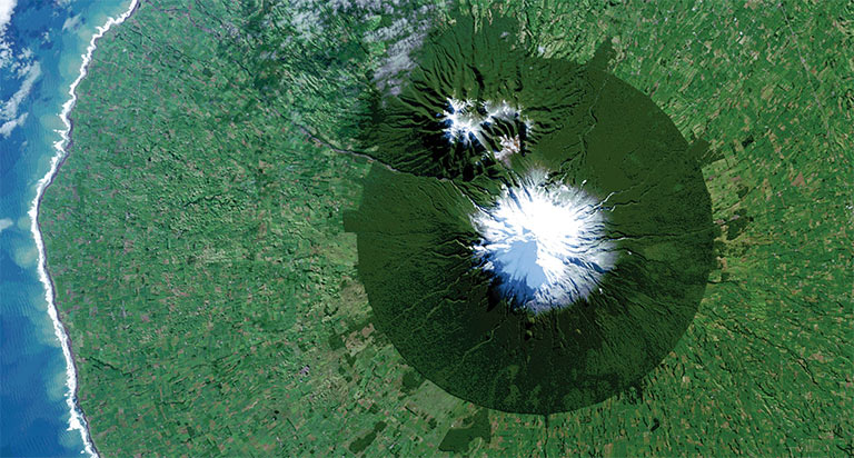 In July 2014, Landsat 8 captured the isolated island of protected forest around New Zealand's Mt. Taranaki in Egmont National Park surrounded by once-forested pasturelands. Credit: NASA/USGS