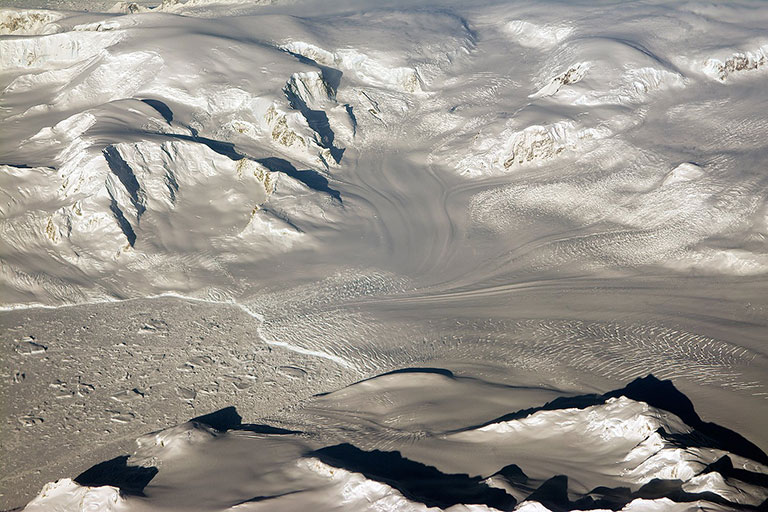 Glaciers seen during NASA's Operation IceBridge research flight to West Antarctica on Oct. 29, 2014. Credit: NASA/Michael Studinger. View larger image.