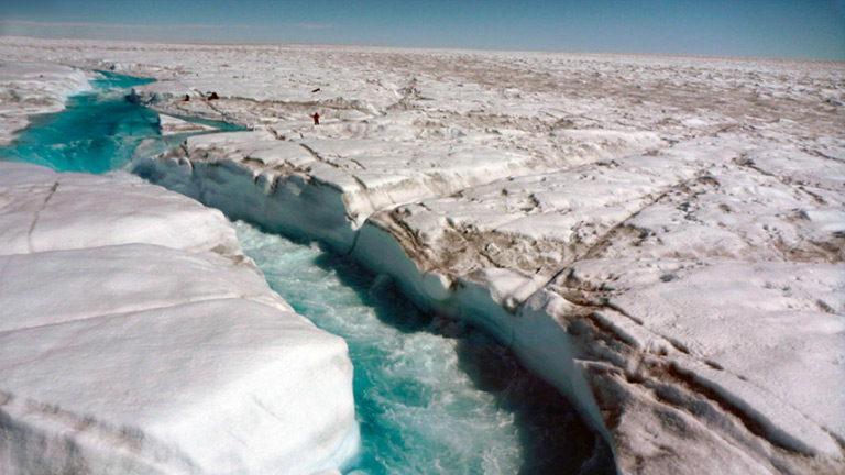 A river of meltwater flowing across Greenland's ice sheet. Credit: UCLA/Laurence C. Smith. View larger image.